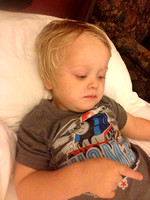 Jackson taking a little break in the hotel room. <3 this boy!